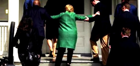 hillary-helped-up-stairs
